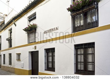 SEVILLE, SPAIN - September 12, 2015: View of a street in the former Jewish quarter (Juderia) of the medieval city of Seville on September 12, 2015 in Seville, Spain