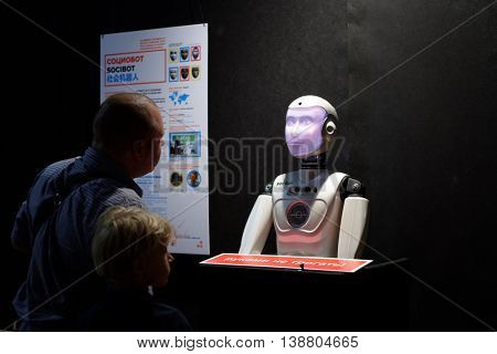 ST. PETERSBURG, RUSSIA - JUNE 28, 2016: People talking with socibot during the interactive exhibition Ball Of Robots. Last year the exhibition was visited by more than 200,000 people