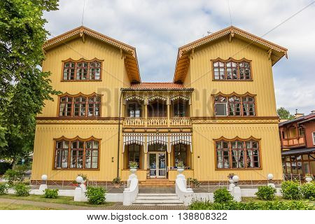 Large yellow wooden mansion in Juodkrante on Curonian Spit in Lithuania