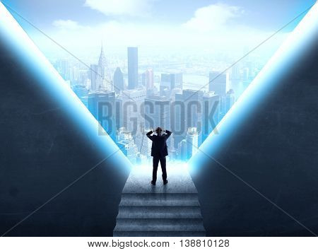 Businessman standing in the prison and looking at the cityscape