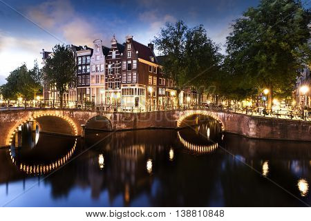 Amsterdam city by night with classified UNESCO canals Netherlands