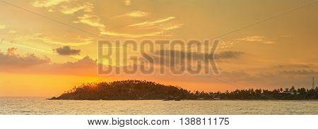 Romantic untouched tropical beach on sunset, Sri Lanka.
