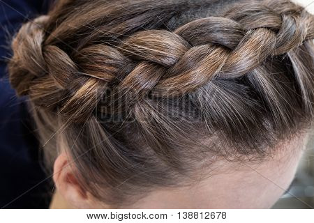 beautiful braid brunette close up