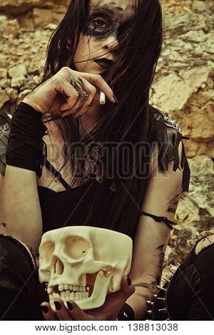 Pretty sad raider posing with cigarette and skull