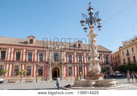 Seville Spain - August 28 2014: Archbishop's Palace of Seville on Plaza de la Virgen de los Reyes.