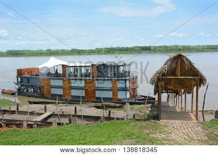 NAUTA, PERU - OCTOBER 17, 2015: The Aqua Amazon River Cruise Ship. The luxury ship is shown at its home port in Nauta on the Itaya River.