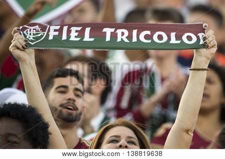 Rio de Janeiro Brazil - April 10 2016: Fan flag in match between Fluminense and Cruzeiro by the Brazilian championship in the Giulite Coutinho Stadium