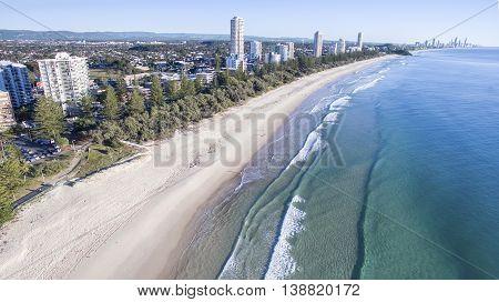 Aerial view of Burleigh beach and Miami Headland in the horizon. Gold Coast, Australia