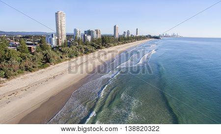 Aerial view of Burleigh beach and Miami Headland in the horizon, at sunrise. Gold Coast, Australia