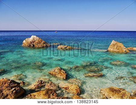 Azure sea coast of the Greek island in the afternoon light