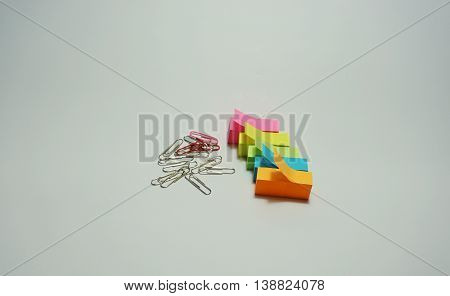 Many clipper and multicolor stick note on white background