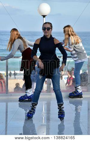Sydney, Australia - Jul 17, 2016. A girl ice skating on Bondi ice rink. Australia's only beachside ice rink is on Bondi beach.