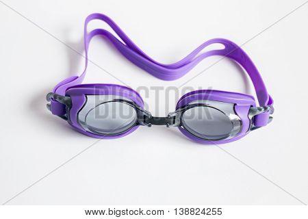 Purple swim goggles isolated on white background stock photo