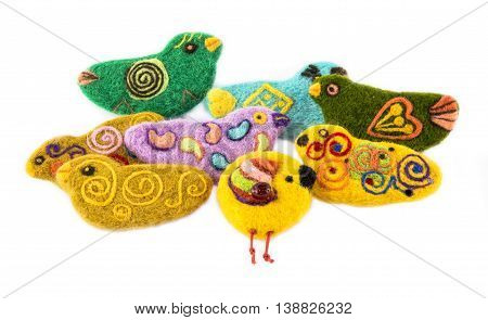 Brooch of fulled wool in the form of birds on a white background