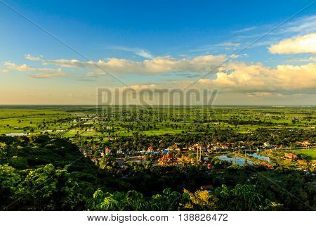 Bird's eye view of the idyllic green Cambodian countryside as the sun sets