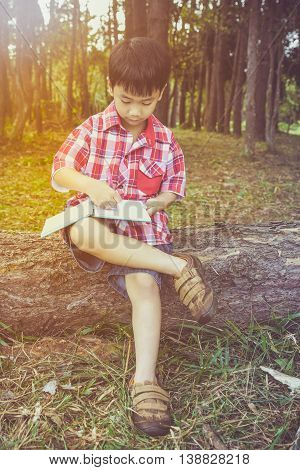 Boy Writing On Book. Education Concept. Vintage Style.