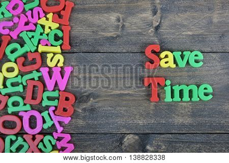 Save Time word on wooden table