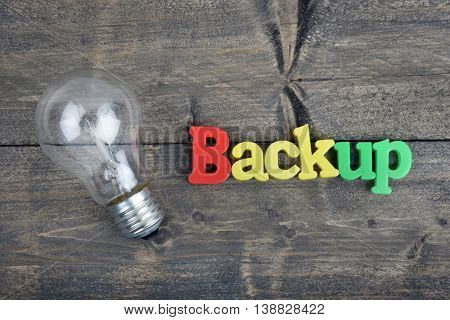 Backup word on wooden table