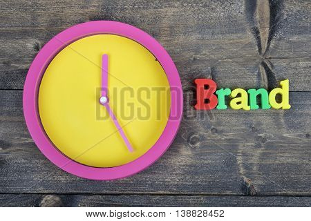 Brand word on wooden table