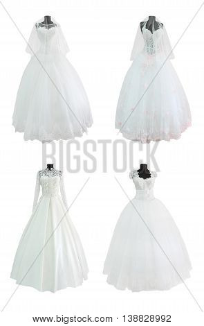 Set of wedding gowns and evening dress on mannequins isolated on white background