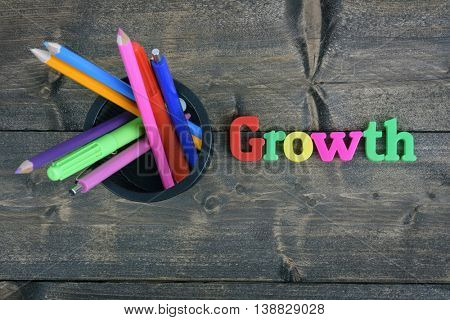 Growth word on wooden table