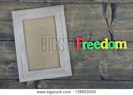 Freedom word on wooden table