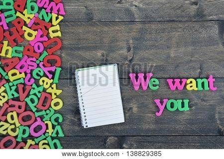 We want you word on wooden table