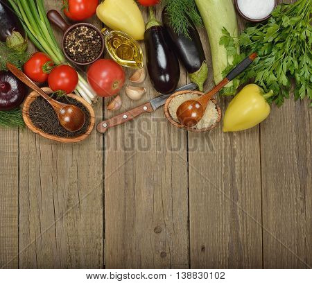 Various vegetables on a wooden background close up