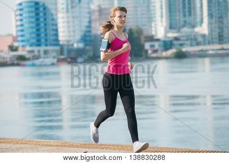 sporty woman running in the city