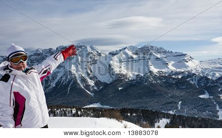 Skier Pointing At The Slopes Of Ski Resort