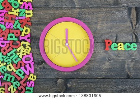 Peace word on wooden table
