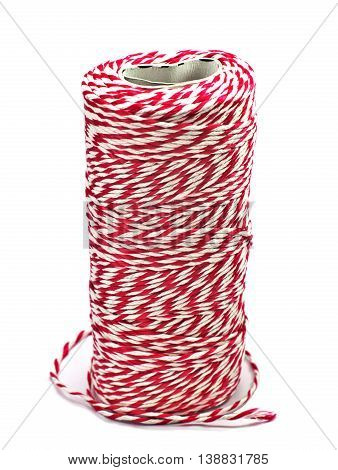 red and white corduroy rope roll stand upright isolated on white background