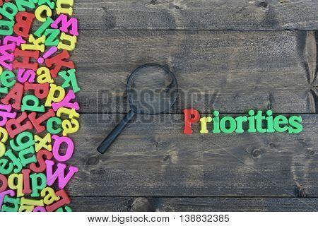 Priorities word on wooden table