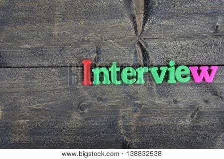 Interview word on wooden table