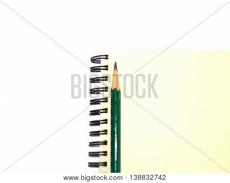 green pencil on a plain ring binder notebook right alignment