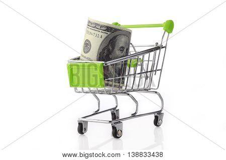 Mini size shopping cart with US Dolar inside on white background