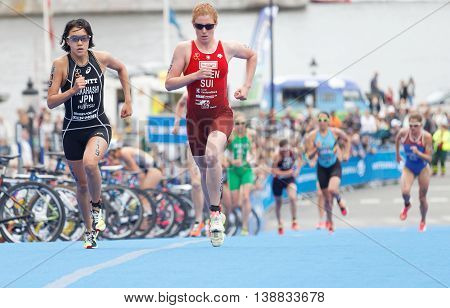 STOCKHOLM - JUL 02 2016: Takahashi and Annen fighting in the transition zone in the Women's ITU World Triathlon series event July 02 2016 in Stockholm Sweden