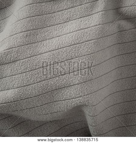 Grey blanket on background with copy space