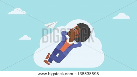 An african-american businessman lying on a cloud and looking at flying paper plane. Businessman relaxing on a cloud. Vector flat design illustration. Horizontal layout.