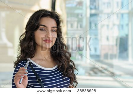 Woman Smokes Electronic Cigarette.