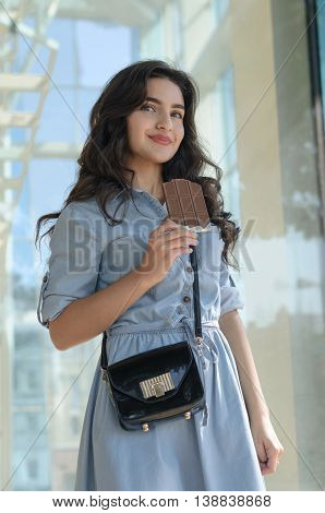 Woman Holding A Bar Of Chocolate.