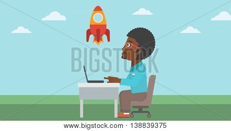 An african-american businessman sitting at the table and looking at a flying rocket. Businessman working on a laptop. Business start up concept. Vector flat design illustration. Horizontal layout.