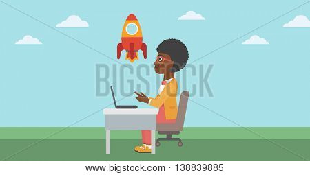 An african-american business woman sitting at the table and looking at a flying rocket. Business woman working on laptop. Business start up concept. Vector flat design illustration. Horizontal layout.