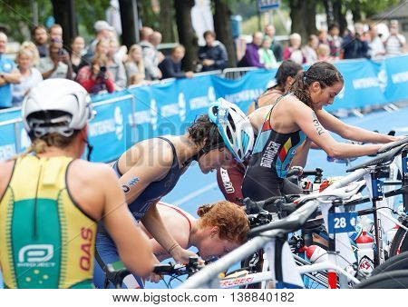 STOCKHOLM - JUL 02 2016: Triathletes change from swimming to cycling the transition zone in the transition zone in the Women's ITU World Triathlon series event July 02 2016 in Stockholm Sweden