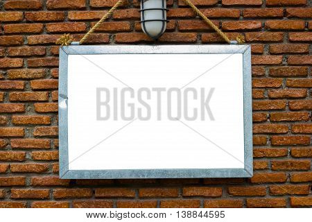 blank billboard hung on a buildings exterior brick wall dark tone background