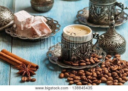 Turkish coffee and turkish delight with traditional embossed metal tray and cup