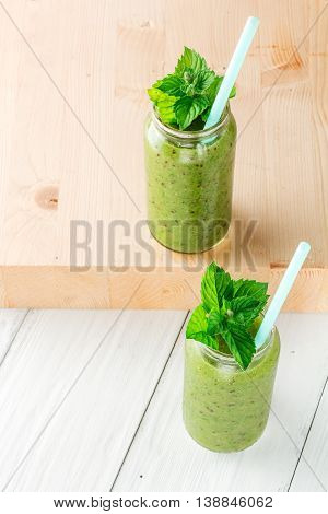 Fruit and vegetable smoothies out of kiwi arugula. Closeup