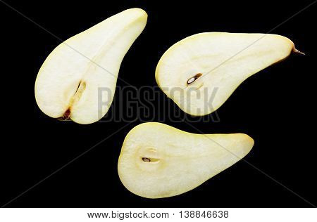 Slices Of Pears On A Black Background