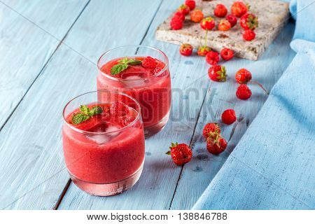 smoothie of strawberries and raspberries on old boards