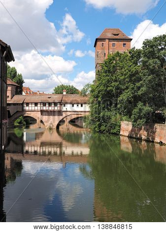 Nuremberg Germany - June 27 2016: Tower bridge and old houses with the Pegnitz river